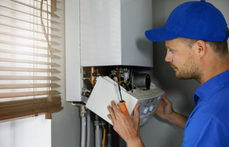 Water heater repair technician with blue hat